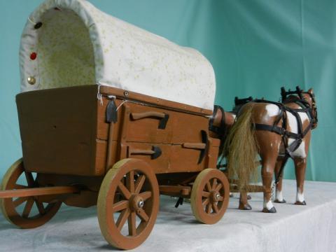 Horses & covered wagon