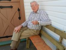 Jack relaxing on a split log bench
